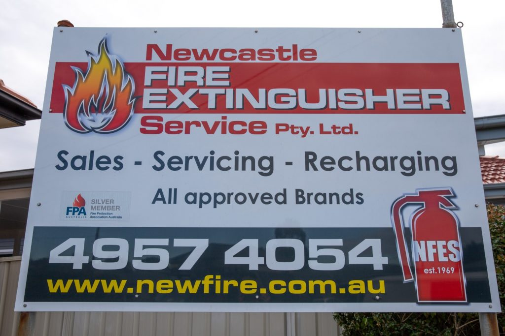 newcastle fire extinguisher service sign